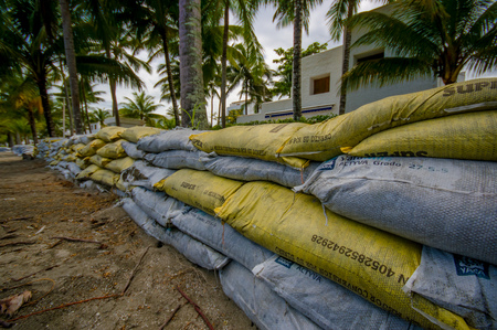 16: Esmeraldas, Ecuador - March 16, 2016: Sandbags to protect against the flood by tsunami in Same Beach, Casablanca Editorial