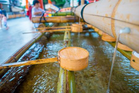 Close up of hand wash pavilion in Fushimi Inari Shrine in Kyoto, Japan Stock Photo