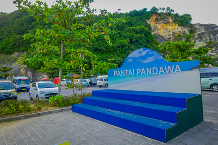 BALI, INDONESIA - MARCH 11, 2017: Informative sign of Pandawa Beach in the south of Bali, Indonesia. Pandawa Beach is a popular tourist destination