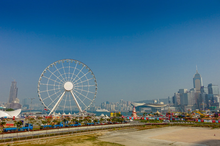 HONG KONG, CHINA - JANUARY 26, 2017: The popular icon Observation Wheel in Hong Kong island, near Ferry Pier arera with landmark buildings in background. Editorial