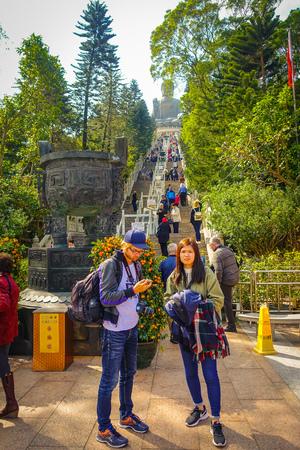 HONG KONG, CHINA - JANUARY 26, 2017: Unidentified people walking upstairs to see the Tian Tin monastery and the Big Buddha at the Po Lin Monastery, Lantau Island, Hong Kong.