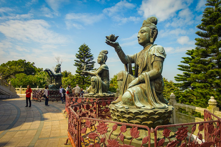 palate: HONG KONG, CHINA - JANUARY 26, 2017: Beautiful statue, located in the entrance of the Tian Tin monastery,in a sunny day in Lantau Island, Hong Kong. Editorial