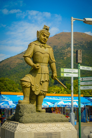 palate: HONG KONG, CHINA - JANUARY 26, 2017: Beautiful stoned statue, located in one side of the entrance of the Tian Tin monastery in Lantau Island, Hong Kong.