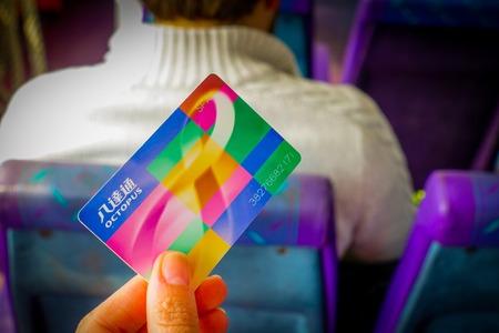 HONG KONG, CHINA - JANUARY 26, 2017: Hnad holding a transport octopus payment card in Hong Kong, China.
