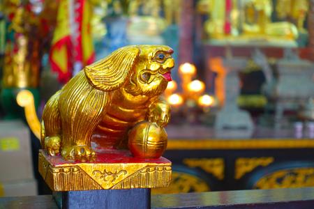 HONG KONG, CHINA - JANUARY 26, 2017: Tsz wan temple, with a hell representation, with a golden statue, in Hong Kong, China.