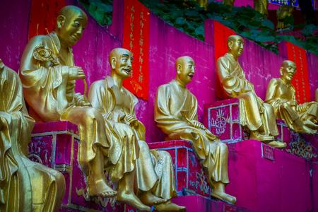 Spectacular golden statues at Ten Thousand Buddhas Monastery in Sha Tin, Hong Kong, China. Stock Photo
