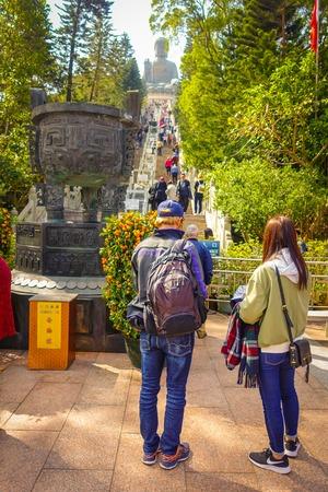 cerulean: HONG KONG, CHINA - JANUARY 26, 2017: Unidentified people walking upstairs to see the Tian Tin monastery and the Big Buddha at the Po Lin Monastery, Lantau Island, Hong Kong Editorial
