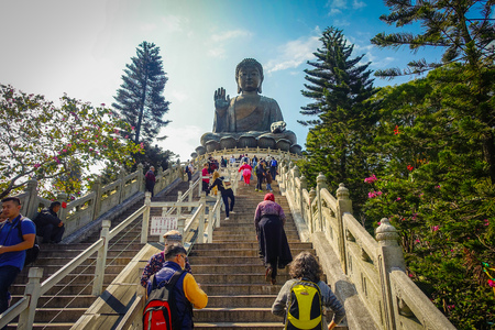 HONG KONG, CHINA - JANUARY 26, 2017: Unidentified people walking upstairs to see the Tian Tin monastery and the Big Buddha at the Po Lin Monastery, Lantau Island, Hong Kong Editorial