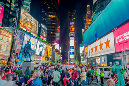 NEW YORK, USA - MAY 05, 2017: Times Square lights at night in Midtown Manhattan. The site is regarded as the worlds most visited tourist attraction with nearly 40 million visitors annually