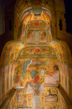 HOUSTON, USA - JANUARY 12, 2017: Beautiful and colorful draws inside of the sarcophagus of the Ancient Egypt in National Museum of Natural Science in Orlando Houston in USA, in a black background