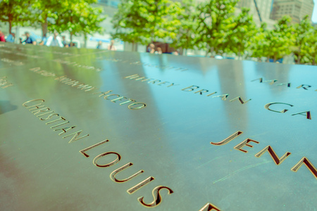 NEW YORK, USA - NOVEMBER 22, 2016: Text close up on Memorial 9-11 monument in Manhattan after the attempted against twin towers in new York Usa