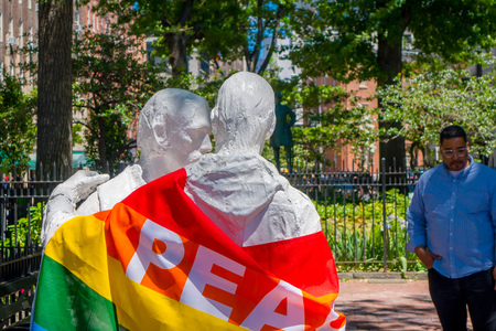 ORLANDO, USA - MAY 05, 2017: Staue with a gay flag with the word peace, in shooting memorial gay in Orlando, Florida, United States Editorial