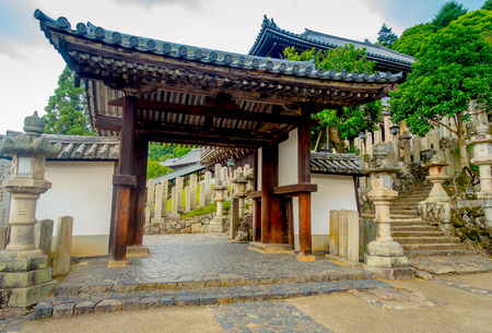 Nara, Japan - July 26, 2017: Principal gate with old traditional architecture and street in Nigatsu-do, Todai-ji temple, Nara Editoriali