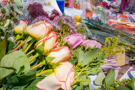 ORLANDO, USA - MAY 05, 2017: Flowers over a place where Omar Mateen, killed 49 people and wounded 53 others in a terrorist attack hate crime in a gay nightclub in Orlando, Florida, United States Editorial