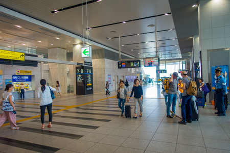 light duty: OSAKA, JAPAN - JULY 18, 2017: Unidentified people at Kansai International Airport, Osaka. It is an international airport located on an artificial island in the middle of Osaka Bay