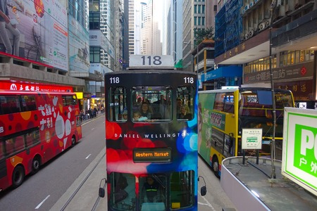 busses: HONG KONG, CHINA - JANUARY 26, 2017: Two double-deck busses in Hong Kong, China. The Double-deck trams system in Hong Kong is one of three and the most famous in the world Editorial