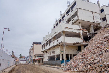 MANTA, ECUADOR- MAY 11, 2017: Building partial destroyed next to a completely destroyed building during a strong earthquake measuring 7.8 on the Richter Scale by the April 16Th, 2016 , South America, Manta Ecuador Editorial