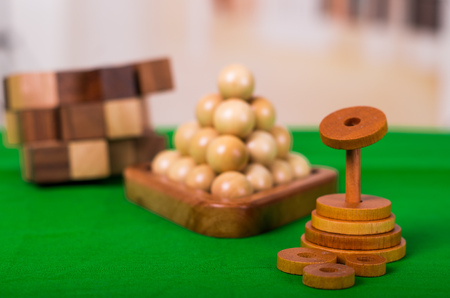 Wooden Brain Teaser or Wooden Puzzles on green floor in blurred background