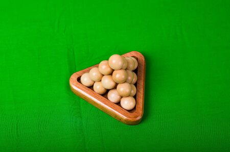 solved: Wooden Brain Teaser or Wooden Puzzles on green background
