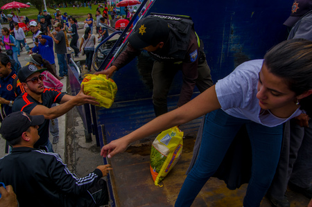 Quito, Ecuador - April,17, 2016: Crowd of people of Quito providing disaster relief food, clothes, medicine and water for earthquake survivors in the coast Stok Fotoğraf - 83967316