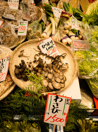 hotate: OSAKA, JAPAN - JULY 18, 2017: Vegetables and black fungus in a market in Kuromon Ichiba market on in Osaka, Japan. it is market places popular in Osaka.