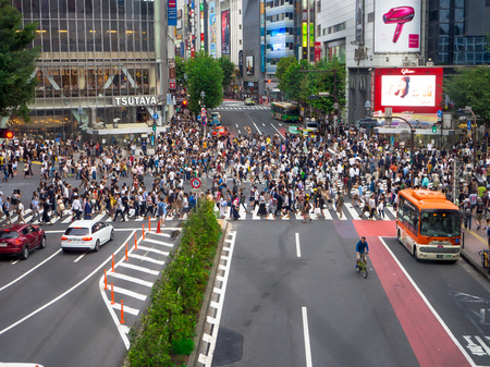 TOKYO, JAPAN JUNE 28 - 2017: Unidentified pedestrians crossing the Shibuya street in Tokyo, Japan. The famous scramble crosswalk is used by over 2.5 million people daily, areial view Editorial