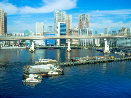 TOKYO, JAPAN JUNE 28 - 2017: Beautiful view of some boats parked in a pier, in a beautiful sunny day with a blue sky in Odaiba, Tokyo