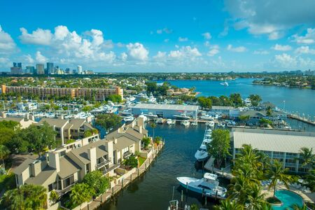FORT LAUDERDALE, USA - JULY 11, 2017: Aerial view of new river with riverwalk promenade highrise condominium buildings and yachts in Fort Lauderdale, Florida