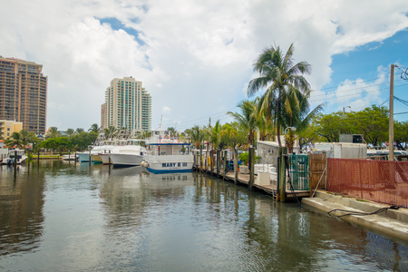 obey: FORT LAUDERDALE, USA - JULY 11, 2017: Many boats displayed in a pier at Fort Lauderdale, Florida Editorial