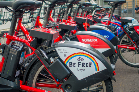 shared sharing: TOKYO, JAPAN JUNE 28 - 2017: Shared bikes are lined up in the streets of Tokyo. Minato Bicycle Sharing, sponsored by Docomo, was launched in October 2014, located in the city of Tokyo Editorial