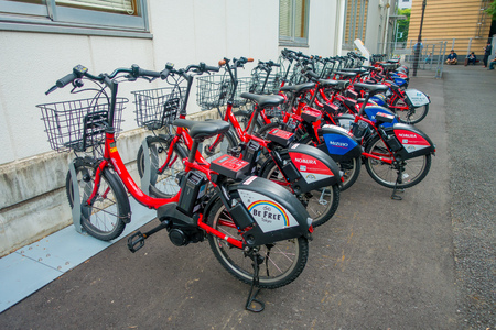 TOKYO, JAPAN JUNE 28 - 2017: Shared bikes are lined up in the streets of Tokyo. Minato Bicycle Sharing, sponsored by Docomo, was launched in October 2014, located in the city of Tokyo Editorial