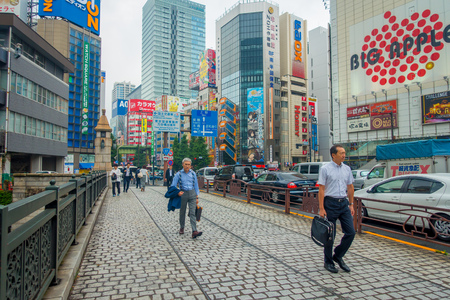computer animation: TOKYO, JAPAN JUNE 28 - 2017: Unidentified people walking in Akihabara district in Tokyo, Japan. The district is a major shopping area for electronic, computer, anime, games