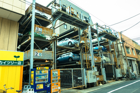 TOKYO, JAPAN -28 JUN 2017: An automated multi-story car parking system. Automatic multi-story car park systems enable to optimize space in crowded cities in Tokyo Editorial