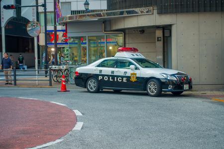 light duty: TOKYO, JAPAN JUNE 28 - 2017: Tokyo Metropolitan Police Department car parked in front of the central station of Tokyo