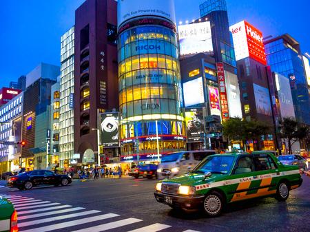 TOKYO, JAPAN -28 JUN 2017: Unidentified people walking in the street through zebra in the Electrical Town of Akihabara, in Tokyo at night Editorial
