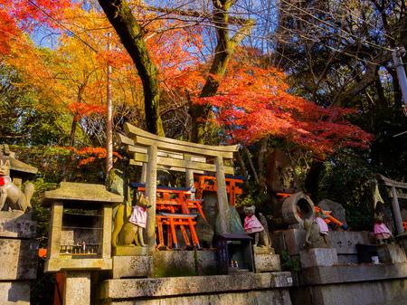 KYOTO, JAPAN - JULY 05, 2017: Fox stone statue at Fushimi Inari Shrine Fushimi Inari Taisha temple in Japan