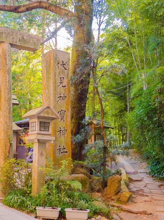 KYOTO, JAPAN - JULY 05, 2017: Stoned path near of red Tori Gate at Fushimi Inari Shrine in Kyoto