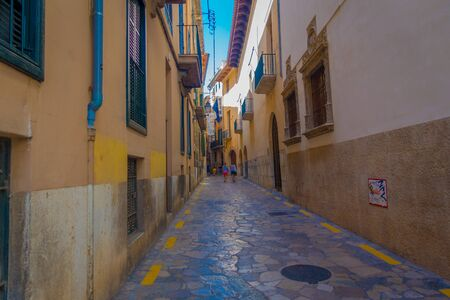 palma: PALMA DE MALLORCA, SPAIN - AUGUST 18 2017: Unidentified people walking in the streets in old city of Palma de Mallorca, Spain