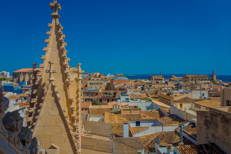 PALMA DE MALLORCA, SPAIN - AUGUST 18 2017: Gorgeous view of rooftops of the city of Palma de Mallorca with the Cathedral of Santa Maria in the horizont in a beautiful blue sunny day in Palma de Mallorca, Spain Stock Photo - 85149361