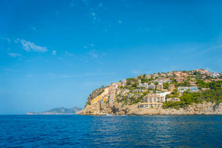 Beautiful view of Mallorca balearic islands, with some buildings in the mountain, in a beautiful blue sky Spain Stock Photo
