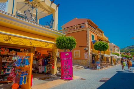 SANT ELM, MALLORCA, SPAIN - AUGUST 18 2017: Unidentified people walking at Sant Elm City, quaint shopping street in the small town of San Telmo, Mallorca, Spain
