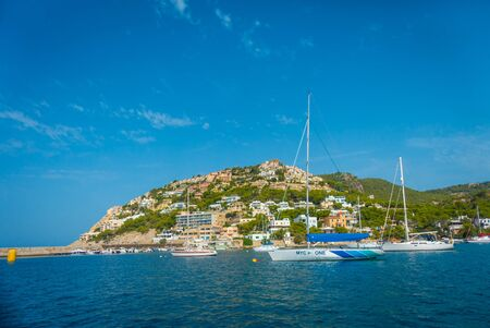 PORT D ANDRATX, SPAIN - AUGUST 18 2017: Andratx port marina in Mallorca balearic islands, with yatchs and some buildings in the horizont, Spain