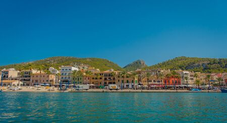 PORT D ANDRATX, SPAIN - AUGUST 18 2017: Beautiful view of Mallorca balearic islands, with some buildings in the horizon, with gorgeous blue water and a beautiful blue sky, in Spain