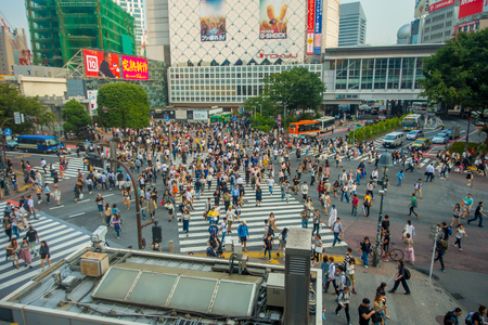 TOKYO, JAPAN JUNE 28 - 2017: Unidentified pedestrians crossing the Shibuya street in Tokyo, Japan. The famous scramble crosswalk is used by over 2.5 million people daily