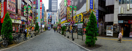 TOKYO, JAPAN JUNE 28 - 2017: Unidentified people walking in the famous Kabukicho red lights district, surrounding of big buildings and advertisements, located in Tokyo Editorial