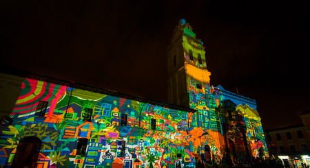 Quito, Pichincha Ecuador - August 9 2017: Close up of spectacle of lights projected on the facade of Church of Santo Domingo, of colorful flowers proyected, during the Quito light festival