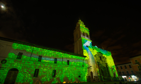 Quito, Pichincha Ecuador - August 9 2017: Close up of spectacle of lights projected on the facade of Church of Santo Domingo, with the amazon river representing the biodiversity of the amazona, during the Quito light festival