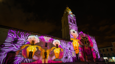 Quito, Pichincha Ecuador - August 9 2017: Close up of spectacle of lights projected on the facade of Church of Santo Domingo, of orchids during the Quito light festival Editorial