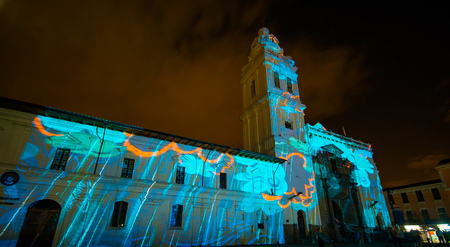 Quito, Pichincha Ecuador - August 9 2017: Close up of spectacle of lights projected on the facade of Church of Santo Domingo, of a blue light, during the Quito light festival