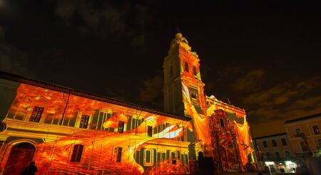 Quito, Pichincha Ecuador - August 9 2017: Close up of spectacle of lights projected on the facade of Church of Santo Domingo, red and yellow representing magma, during the Quito light festival Editorial